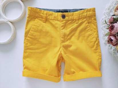 7 лет, рост 122 Желтые шорты